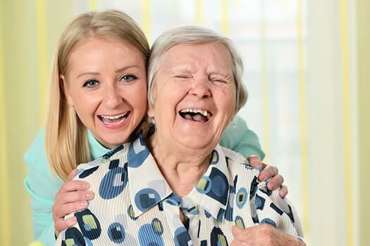 Happy-Senior-Woman-with-Caregiver